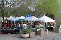 Shoppers browse the 23rd Street Renaissance Market on the drag across the street from the UT campus and features the handiwork of some great local artisans in Austin, Texas, USA