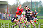 Mary Herlihy of Sliabh Luachra releases the ball before the tackle of  Donoughmore's Aisling Barrett last Saturday in the Ladies Munster Final held in Paddy Carroll Park, Ballyagran.