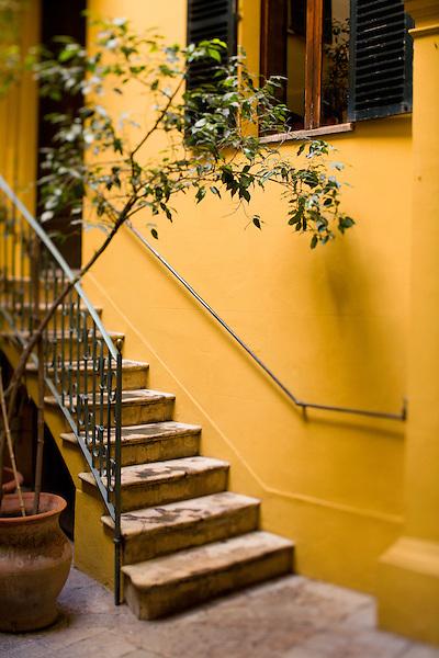 A colorful courtyard in Palma, Mallorca. Photo by Kevin J. Miyazaki/Redux