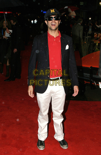 "JOHNNY KNOXVILLE.""The Dukes Of Hazzard"" UK Film Premiere, Vue Leicester Square, London..August 22nd, 2005.full length sunglasses shades hat blue jacket uniform captain red shirt white trousers mouth open.www.capitalpictures.com.sales@capitalpictures.com.© Capital Pictures."