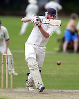 Ed Atkins bats for Highgate during the Middlesex County Cricket League Division Three game between Highgate and North London at Park Road, Crouch End on Sat July 12, 2014
