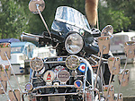 A Star 125, clone from India of classic Vespa PX, highly customized in 'Mod' style with chrome bars and mirrors.