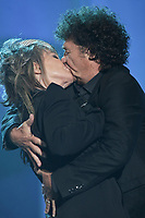 "Robert Charlebois and Diane Dufresne kisse at the ""Paris-Quebec"" show of the 44th Festival d'ete de Quebec on the Plains of Abraham in Quebec city Thursday July 7, 2011."