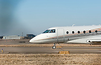 Private and corporate jets line the runway at Love Field Airport in Dallas, Texas, Monday, February 7, 2011. After a difficult slump, private jet travel is making a modest comeback. ..Matt Nager for The Wall Street Journal