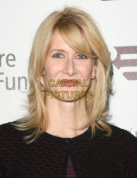 Laura Dern.'Reel Stories, Real Lives' Celebration of the Motion Picture & Television Fund' 90 Years of Service to the Community and Recognizes The Hollywood Reporter's Next Generation Class of 2011 held at Milk Studios in Los Angeles, California, USA..headshot portrait black red.CAP/RKE/DVS.©DVS/RockinExposures/Capital Pictures.