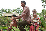 Sing Chum and her family head home from the school in Kok Thnot Commune Village.