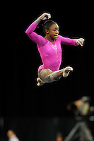 02/20/09 - Photo by John Cheng for USA Gymnastics. American gymnast Hallie Mossett performs on floor exercise in a meet against Japan before the Tyson American Cup at Sears Centre Arena in Chicago.
