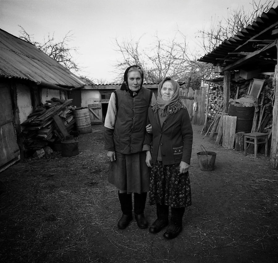Chernobyl, Ukraine, Ocober 1995..The explosion at the Chernobyl Nuclear Power Plant on April 26 1986 was the worst nuclear accident in history..Like many older residents Ulyanna Kolyenchuk [left] & Maria Kirilenko have returned to live illegally in their homes in the closed and radioactive zone surrounding Chernobyl.