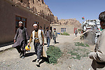 Workers who have begun to renovate the space around a former Buddha statue in Bamiyan, Afghanistan, before it was destroyed by the Taliban in 2001, finish their last day of work for the season on May 30, 2011, in Bamiyan, and gather to collect their paychecks.  Photo by Ted Richardson