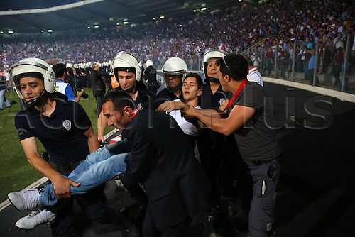22.05.2013. Ankara, Turkey.  Turkish Cup Final Match between Fenerbahce   and Trabzonspor   in Ankara Turkey  The match finished Fenerbahce 1 Trabzonspor 0. Supporters are taken away by the Police