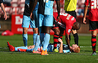 Ryan Sellers of Wycombe Wanderers lays motionless after a challenge from Clinton Morrison of Exeter City during the Sky Bet League 2 match between Exeter City and Wycombe Wanderers at St James' Park, Exeter, England on 26 September 2015. Photo by Pinnacle Photo Agency.