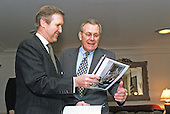 United States Secretary of Defense William S. Cohen (left) and US Secretary of Defense-designate Donald H. Rumsfeld (right) look at old photographs as they meet in Cohen's Pentagon office for a working breakfast on January 5, 2001.  Cohen and Rumsfeld are meeting to discuss defense issues and the transition.  The photographs are of Rumsfeld during his previous term as Defense secretary from November 20, 1975 through January 20, 1977. <br /> Mandatory Credit: Robert D. Ward / DoD via CNP