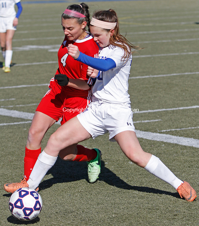 WATERBURY, CT-11 November 111514MK09 Housatonic's Ann Boslo battle's Portland's Deidra Caruso for the ball during Class S soccer finals at Municipal Stadium on Saturday afternoon.  Portland won in overtime 2 -1. Michael Kabelka / Republican-American