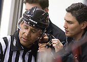 Glen Cooke is checked out by Bernard Walls (Providence - Trainer) after being hit in the side of the head by a shot. - The Northeastern University Huskies defeated the visiting Providence College Friars 5-0 on Saturday, November 20, 2010, at Matthews Arena in Boston, Massachusetts.