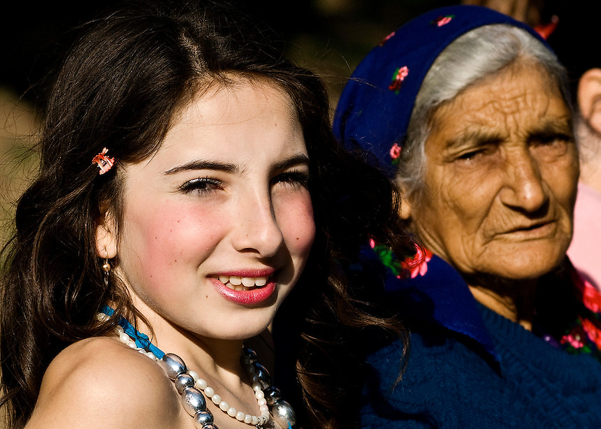 "Donka Angelova, 13 and an her grandmother, dressed with traditional Tinsmith's costume during the annual ""bride market"" at the Bachkovo monastery, in Asenograd, Bulgaria. Young girls like Donka, accompanied their older sisters on the day of the Assumption of the Virgin Mary, when Roma from the Tinsmith branch gathered at the monastery to introduce their daughters at the age for marriage to boys from the same clan."