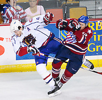 April 28, 2007; Hamilton, ON, CAN; Hamilton Bulldogs defenceman (4) Dan Jancevski and Rochester Americans left winger (12) David Booth collide during game six of the AHL north division semifinal at Copps Coliseum. The Bulldogs won 6-2 and eliminated the Americans from the playoffs. Mandatory Credit: Ron Scheffler, Special to the Spectator. (File number RRSA8415).