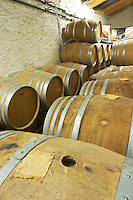 Oak barrique barrels with fermenting white wine, bung hole covered with jute Chateau Belingard Bergerac Dordogne France