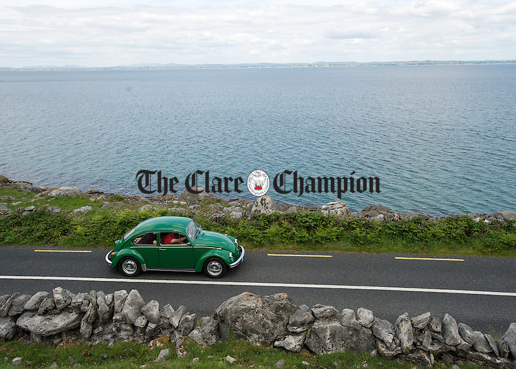 A vintage car returns to base along the coast road during a vintage run as part of Feile an Samhraidh at Ballyvaughan. Photograph  by John  Kelly.