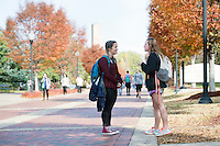 Old Main Plaza fall leaves: Mary Michael Bellin talking with fellow kinesiology major Lauren Moran. (photo by Megan Bean / © Mississippi State University)