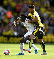 Bafetimbi Gomis of Swansea battles with Etienne Capoue of Watford    during the Barclays Premier League match Watford and Swansea   played at Vicarage Road Stadium , Watford
