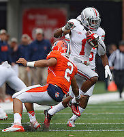 Ohio State Buckeyes cornerback Bradley Roby (1) avoids a tackle by Illinois Fighting Illini quarterback Nathan Scheelhaase (2) after an interception in first quarter action at Memorial Stadium in Champaign, Illinois on November 16, 2013.  He ran it back for a TD.(Chris Russell/Dispatch Photo)