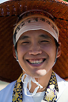"Smiling Henro on the Shikoku Pilgrimage - the Pilgrimage is a trail of 88 temples on Shikoku and is believed that all 88 temples were visited by the famous Buddhist monk Kukai, founder of the Shingon school, who was born at Zentsuji Temple in 774.  To complete the pilgrimage, it is not necessary to visit the temples in order.  The pilgrimage is traditionally completed on foot, but modern pilgrims use cars, taxis, buses, bicycles or motorcycles. The walking course is approximately 1200km long and can take anywhere from 30 to 60 days to complete. ""Henro"" is the Japanese word for pilgrim - they are recognizable by their white clothing,  special walking sticks with bells and sedge hats."