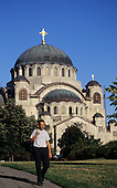 Belgrade, Serbia, Yugoslavia. Man walking in front of St Sava's Temple, on the Vracar Plateau.