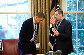 Washington, DC - May 8, 2009 -- United States President Barack Obama talks with Mark Lippert,  Chief-of-Staff at the National Security Council, in the Oval Office prior to a phone call with President-elect Jacob Zuma of South Africa on May 8, 2009. .Mandatory Credit: Pete Souza - White House via CNP