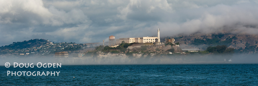 Alcatraz Island with the ever present fog, San Francisco Bay, California
