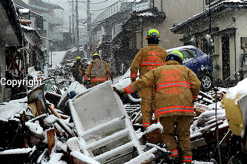 Members of the Fairfax County, Va., Task Force 1 Urban Search and Rescue search structures and debris on March 16, 2011 in Kamaishi, Japan. A 9.0 earthquake hit Japan on March 11, 2011 that caused a tsunami that destroyed anything in its path.