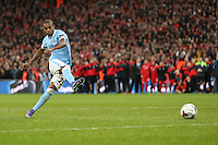 Fernandinho of Manchester City takes his penalty during the Capital One Cup match between Liverpool and Manchester City at Wembley Stadium, London, England on 28 February 2016. Photo by David Horn / PRiME Media Images.