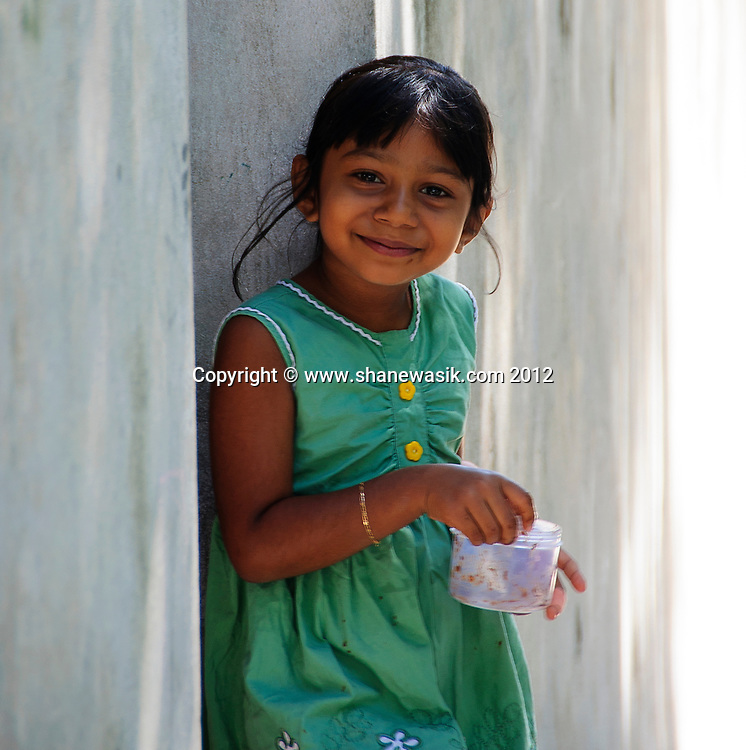 A local Maldivian girl smiles at the visitors. Many visitors never get to see the 'real' Maldives in the local villages, a complete contrast to the upmarket resorts.