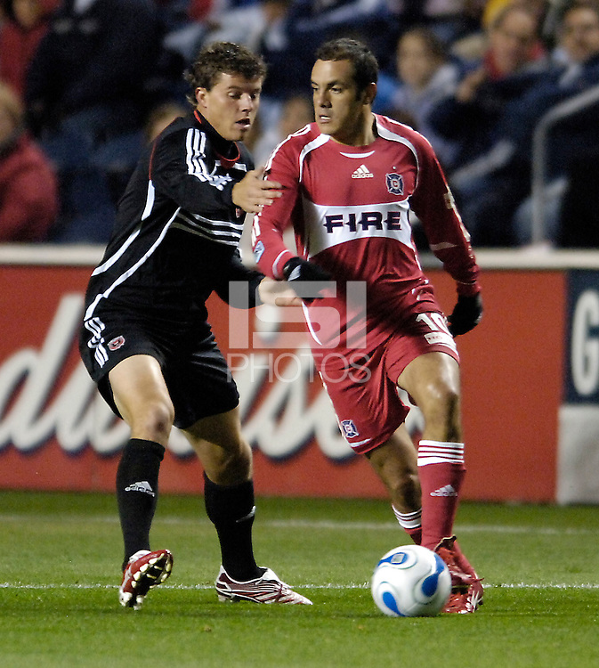 Chicago Fire forward Cuauhtemoc Blanco (10) shields the ball from D.C. United defender Marc Burch (4). The Chicago Fire defeated D. C. United 1-0 during the first leg of the MLS Eastern Conference Semifinal Series at Toyota Park in Bridgeview, IL, on October 25, 2007.