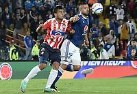 BOGOTA - COLOMBIA, 09-09-2018: Andres Cadavid Cardona (Der) jugador de Millonarios disputa el balón con Jefferson Gomez (Izq) jugador de Atlético Junior durante partido por la fecha 9 de la Liga Águila II 2018 jugado en el estadio Nemesio Camacho El Campin de la ciudad de Bogotá. / Andres Cadavid Cardona (R) player of Millonarios fights for the ball with Jefferson Gomez (L) player of Atletico Junior during the match for the date 9 of the Liga Aguila II 2018 played at the Nemesio Camacho El Campin Stadium in Bogota city. Photo: VizzorImage / Gabriel Aponte / Staff.