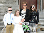 Mia O'Byrne who received first holy communion at St Mary's church  pictured with mam Anna Marie, brother Callum and sister Alex. Photo:Colin Bell/pressphotos.ie