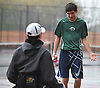 Bobby Bellino of Harborfields, right, has a laugh with doubles partner Nate Melnyk as rain intensifies during their varsity boys tennis match against host Smithtown High School East on Tuesday, Apr. 29, 2016. Melnyk, a wheelchair-using junior, played in his first varsity match, which was suspended in the first set due to the inclement weather. The match is set to resume on Monday, May 2.