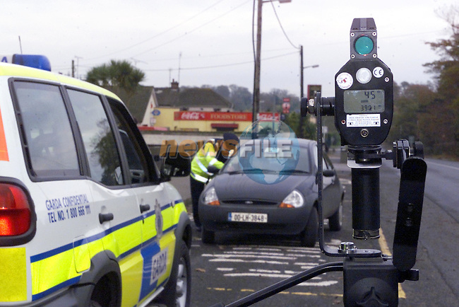 Garda John O'Flaherty issueingthe first summons and penalty points to a motorist who was travelling at 45 mph in a 30 mph school zone..Picture Fran Caffrey Newsfile...This Picture is sent to you by:..Newsfile Ltd.The View, Millmount Abbey, Drogheda, Co Louth, Ireland..Tel: +353419871240.Fax: +353419871260.GSM: +353862500958.ISDN: +353419871010.email: pictures@newsfile.ie.www.newsfile.ie