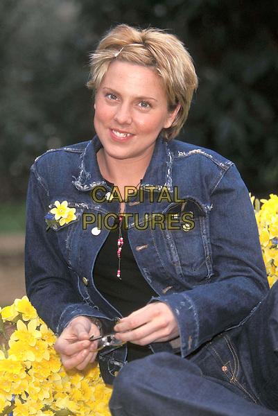 MEL C..Marie Curie Daffodil Appeal..Ref: 9436 ..daffodils, half length, denim..www.capitalpictures.com..sales@capitalpictures.com..©Capital Pictures