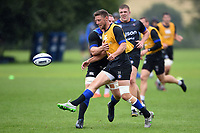 Rhys Priestland of Bath Rugby puts boot to ball. Bath Rugby pre-season training session on August 9, 2017 at Farleigh House in Bath, England. Photo by: Patrick Khachfe / Onside Images