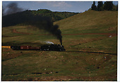 C&amp;TS #497 climbing in the Wolf Creek Valley with a simulated freight train.<br /> C&amp;TS  Wolf Creek Valley, CO  Taken by Dorman, Richard L.