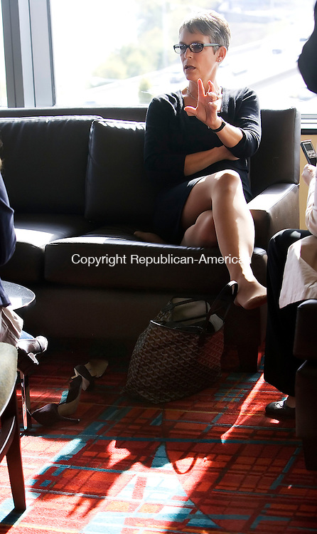 HARTFORD, CT- 26 OCT 2007- 102607JT03- <br /> Sitting on a couch with her shoes kicked off, actress Jamie Lee Curtis speaks with a group of women during a private meet-and-greet during the Business Women's Forum at the Connecticut Convention Center in Hartford on Friday. The event, which also included workshops and a luncheon for roughly 800 attendants, marks the forum's 25th anniversary.<br /> Josalee Thrift / Republican-American
