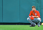 6 March 2012: Washington Nationals outfielder Bryce Harper takes a breather in the outfield during a Spring Training game against the Atlanta Braves at Champion Park in Disney's Wide World of Sports Complex, Orlando, Florida. The Nationals defeated the Braves 5-2 in Grapefruit League action. Mandatory Credit: Ed Wolfstein Photo