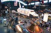 Wide view of the James S. McDonnell Space Hanger at the Smithsonian National Air and Space Museum Steven F. Udvar-Hazy Center in Chantilly, Virginia on December 11, 2004.  The hanger is dominated by the Space Shuttle Enterprise.  Other spacecraft can be seen in the foreground and a left to give a perspective on the size of the shuttle relative to previous manned spacecraft.  The spacecraft at lower right is a test Apollo spacecraft with its flotation collar attached and airbags deployed.  These helped secure the spacecraft in the water after it returned from space..Credit: Ron Sachs / CNP.(RESTRICTION: NO New York or New Jersey Newspapers or newspapers within a 75 mile radius of New York City)