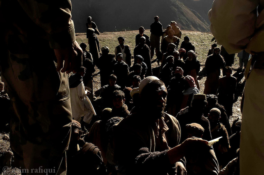 desperation marks the faces of men attempting to receive tents at a pakistan army distribution center<br />