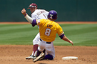 Texas A&M Aggies second baseman Blake Allemand (1) turns a double play as LSU Tigers baserunner Mason Katz (8) slides into second base during the NCAA Southeastern Conference baseball game on May 11, 2013 at Blue Bell Park in College Station, Texas. LSU defeated Texas A&M 2-1 in extra innings to capture the SEC West Championship. (Andrew Woolley/Four Seam Images).