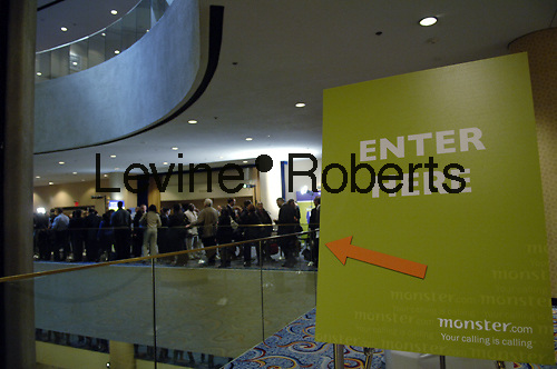 People line up for a job fair sponsored by Monster.com at the Marriott Marquis Hotel in Times Square in New York on Thursday, March 5, 2009. 90 employers were at the event offering hundreds of jobs.  (© Frances M. Roberts)