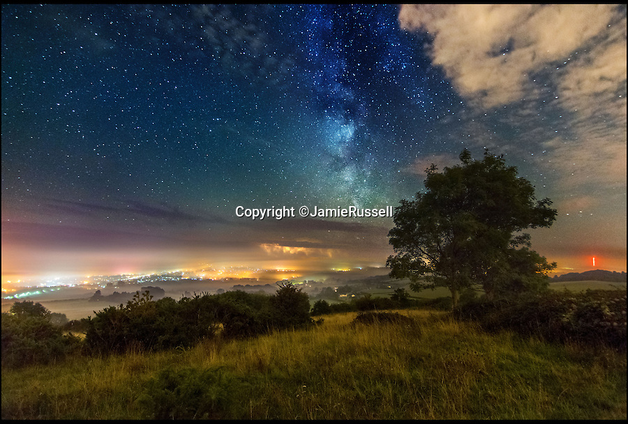 BNPS.co.uk (01202 55883£)<br /> Pic: JamieRussell/BNPS<br /> <br /> ***Please Use Full Byline***<br /> <br /> Brading Down, distant storm. <br /> <br /> Stunning photographs have revealed a turbulent side to the normally genteel Isle of Wight.<br /> <br /> The seemingly benign south coast holiday destination has been catalogued over a stormy year by local photographer Jamie Russell, and his astonishing pictures reveal the dramatic changes in weather that roll across the UK in just 12 months.<br /> <br /> Lightning storms, ice, floods, gales and blizzards have all been captured by the intrepid photographer who frequently got up in the middle of the night to capture the climatic chaos.<br /> <br /> Looking at these pictures prospective holidaymakers could be forgiven for thinking twice about a gentle staycation on the south coast island.