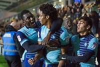 Sido Jombati of Wycombe Wanderers celebrates scoring his side's winning goal with Aaron Pierre and team mates during the Sky Bet League 2 match between Newport County and Wycombe Wanderers at Rodney Parade, Newport, Wales on 22 November 2016. Photo by Mark  Hawkins.