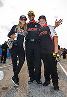 Sep 4, 2017; Clermont, IN, USA; NHRA top fuel driver Leah Pritchett (left) with husband Gary Pritchett (center) and a crew member for Steve Torrence after winning the US Nationals at Lucas Oil Raceway. Mandatory Credit: Mark J. Rebilas-USA TODAY Sports