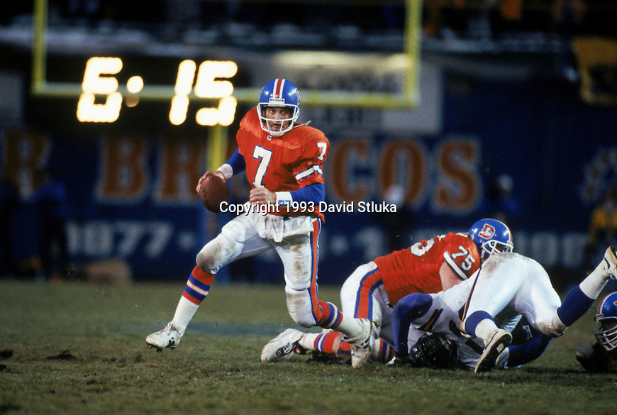 Denver Broncos quarterback John Elway (7) scrambles for yardage during an NFL football game against the Minnesota Vikings at Mile High Stadium on November 14, 1993 in Denver, Colorado.  The Vikings won 26-23. (Photo by David Stluka)